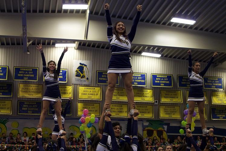 Cheerleaders demonstrating an extension at the pep rally
