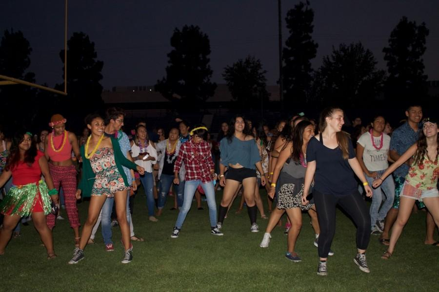 BCCHS students enjoying the Aloha Dance outside at night in the football stadium