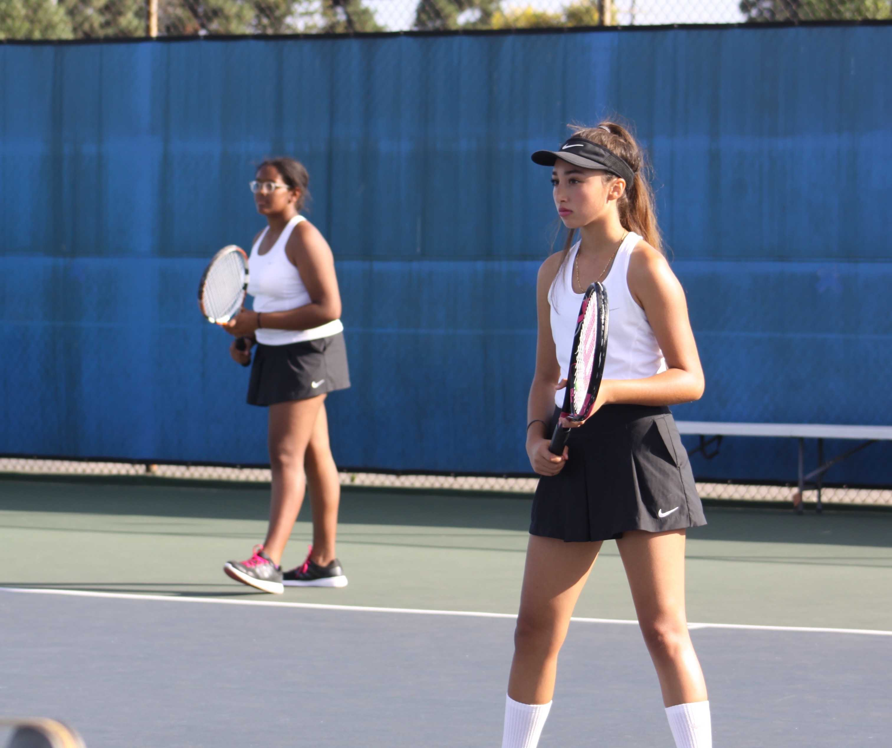 Alyse Cunningham (9) & Yesenia Fernandez (10) play doubles for BCCHS