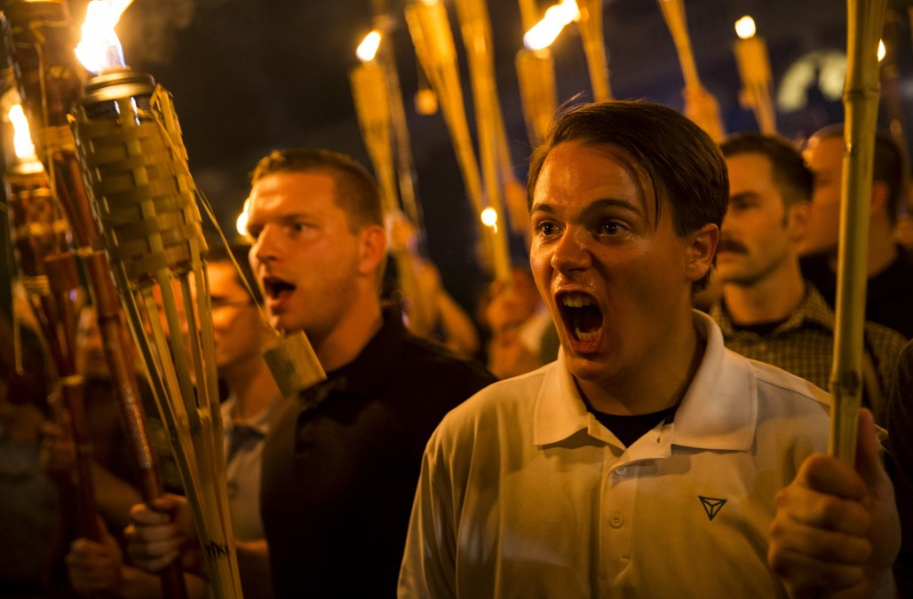 White supremacists gather  in Charlottesville committing racist acts.