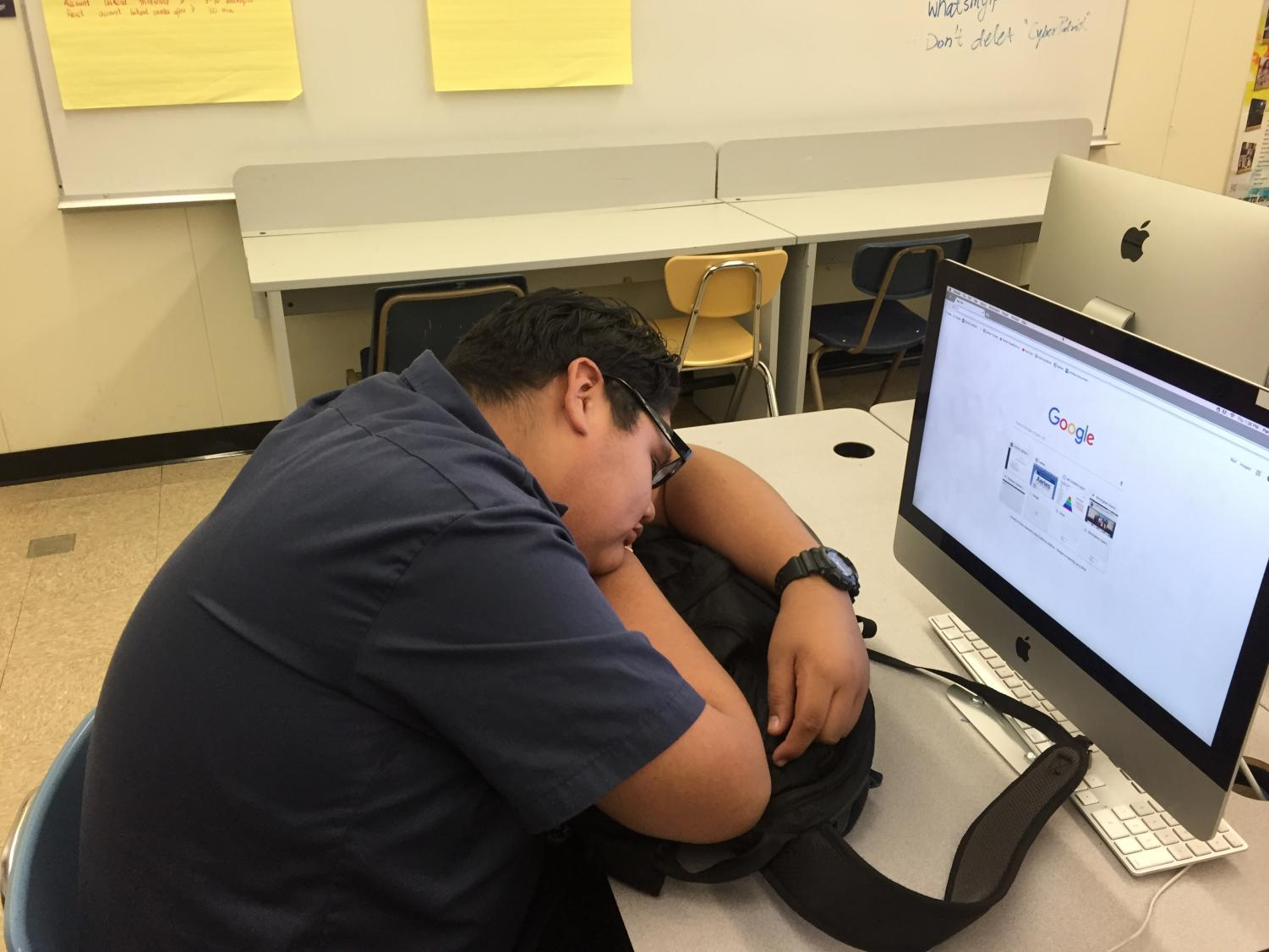 Senioritis at its finest!  Instead of doing school work, this senior takes a nap in class.