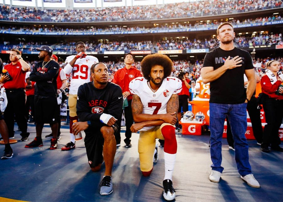 Colin+Kaepernick+Takes+a+Knee+During+the+National+Anthem