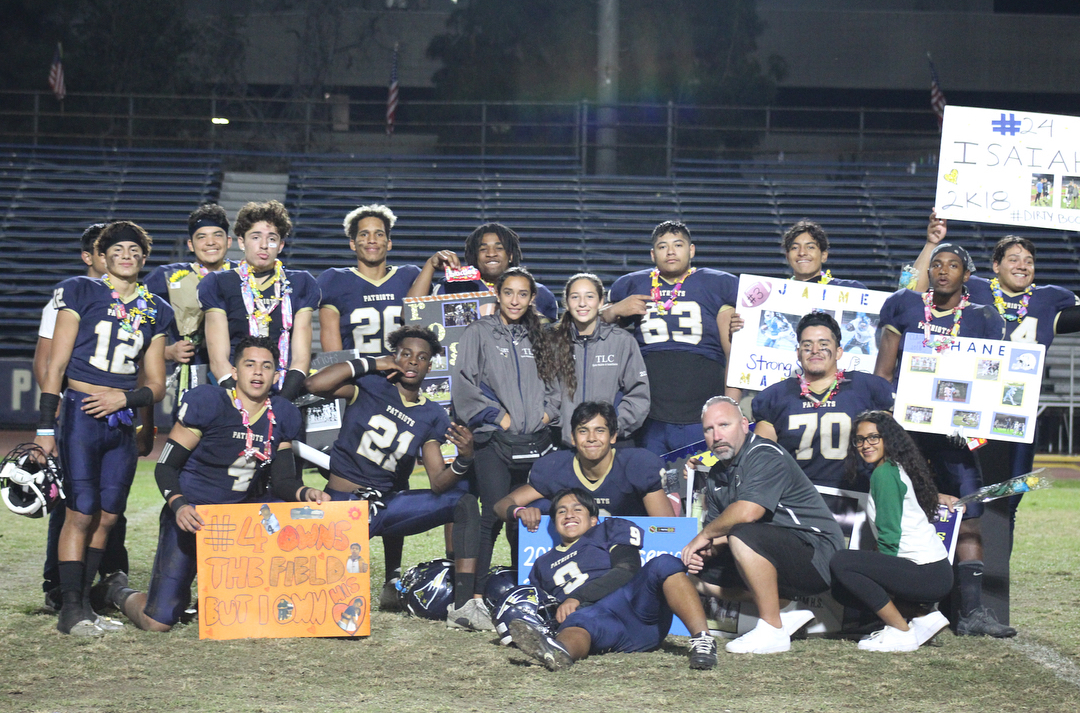 Football Seniors and a couple other teammates with Coach Rose on Senior Night