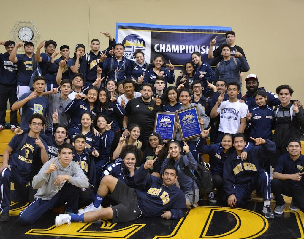The whole wrestling team team, celebrating winning CIF Duals for both girls and boys.