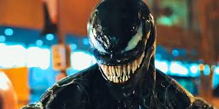 Venom smiling as his movie claims the top spot at the box office.