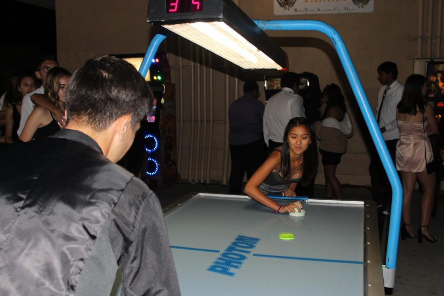 Students playing pool hockey outside the gym, which was provided by Pegled Entertainment.