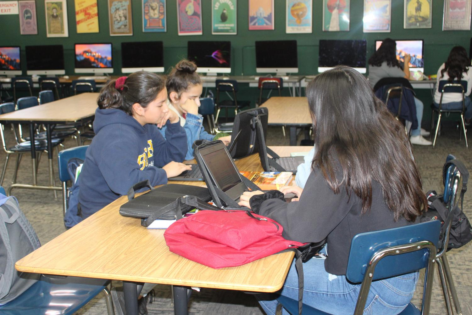 Freshmen students seen using their Chromebooks during their free time.