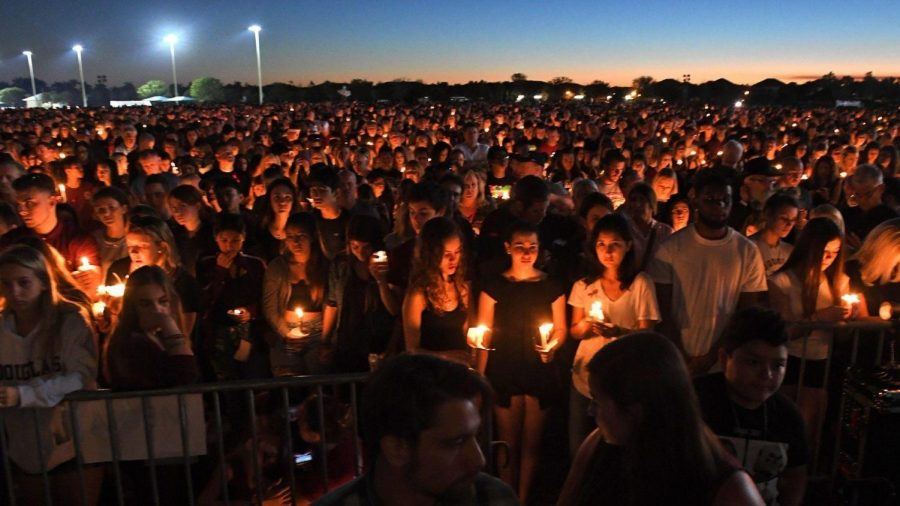 People mourning at a vigil in response to the high school shooting in Parkland, Florida on February 14, 2018.
