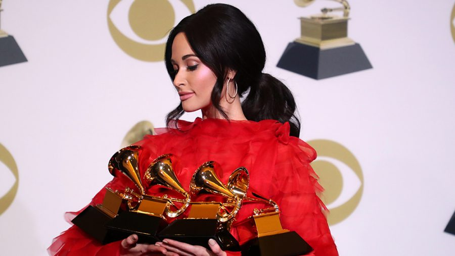 Kacey Musgraves holding her 4 Grammys