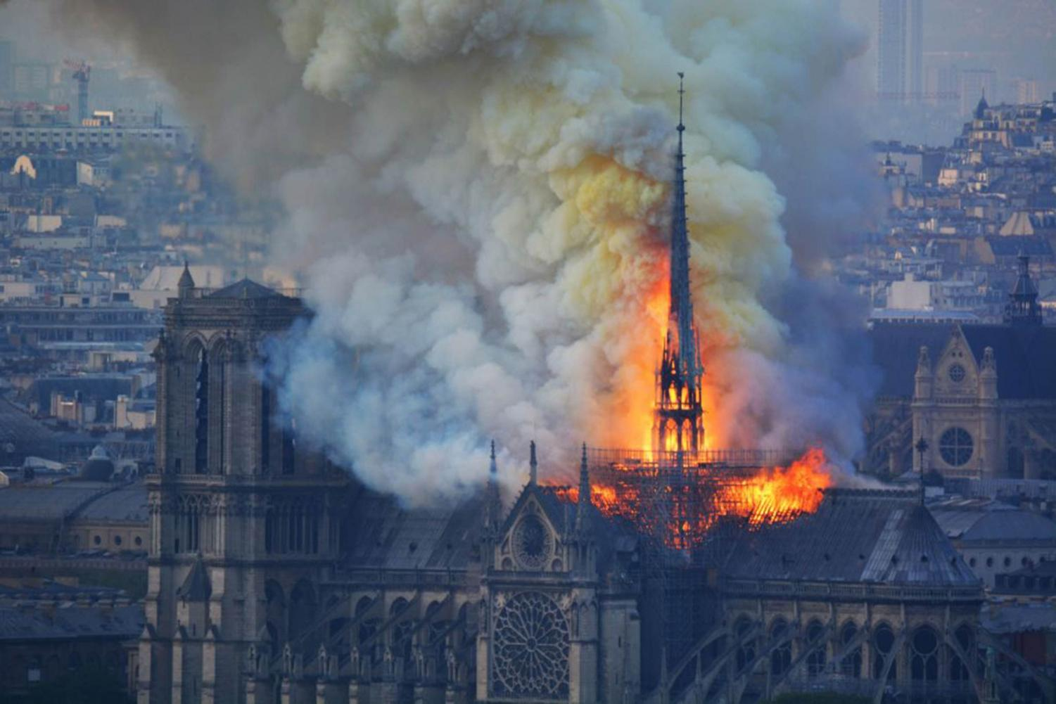 The Norte Dame Cathedral bursting in flames.