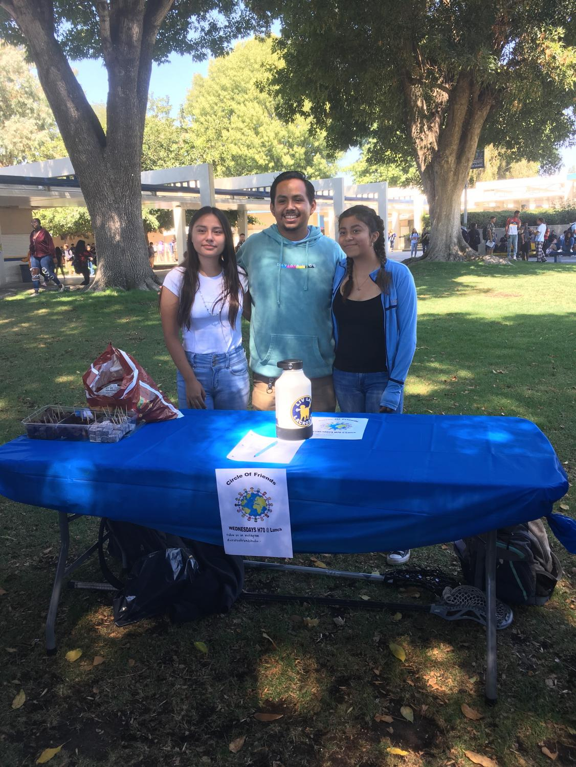 Rebecca Castillo, Eric Marcos, and Divialin Lucero representing their club Cirlce of Friends.