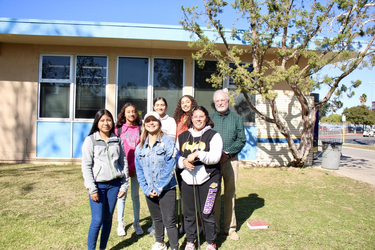 2019-2020 BCCHS Girl's Golf Team: (left to right bottom row) Evelin Lopez (11), Angelica Platas (12), Leah Chavarria (11). (left to right top row) Sarah Amaya (9), Miroslava Haro (11), Sarah Medina (12), Coach Kevin Kelly.  Not pictured is Kimberly Platas (10).