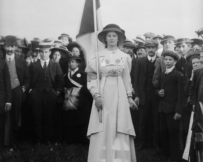 suffragette in front of a crowd of supporters