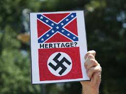 A sign comparing the Confederate flag to the Nazi flag. Symbols of heritage or of racial hatred?